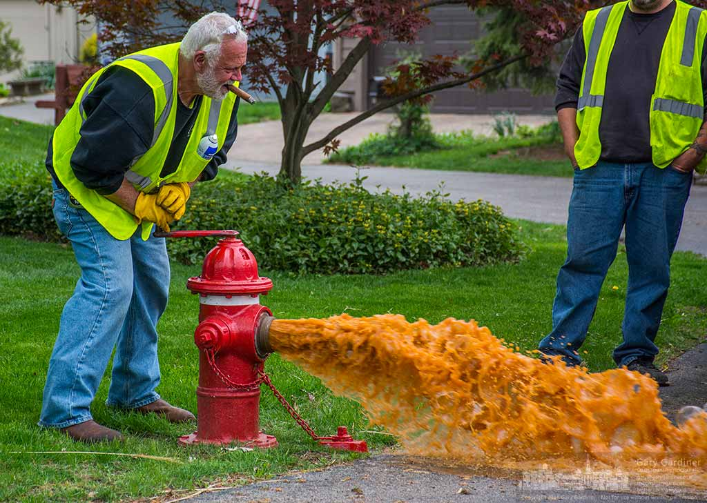 Rust-colored water bursts from a fire hydrant after it is first opened off Schrock Road as city workers test and lubricate emergency services components. My Final Photo for April 27, 2016.