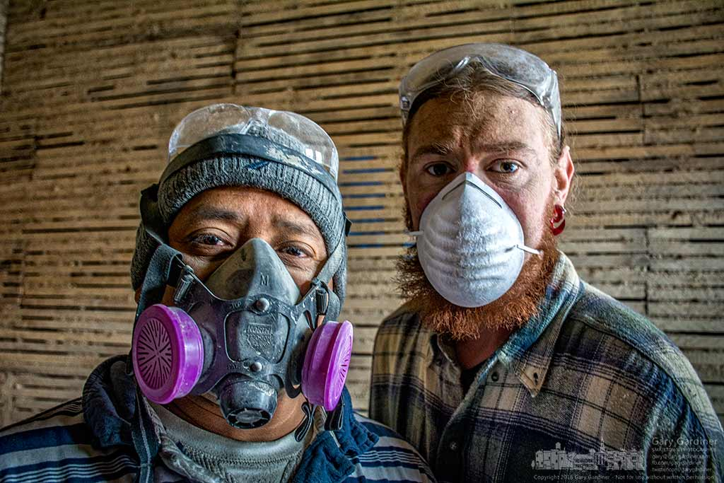 Osmam, left, and Joe take a  break from removing plaster during renovation at Doris' Flowers in Uptown Westerville. My Final Photo for April 7, 2016.