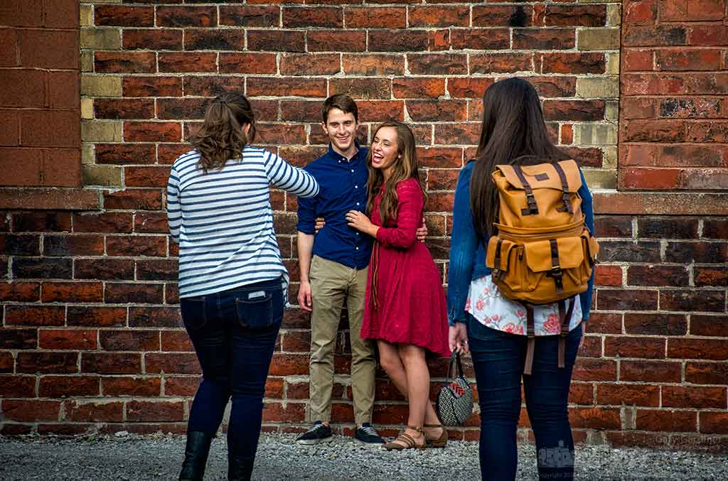A couple laughs as they are directed by a photographer and her assistant while having their portraits taken in an alley in Uptown Westerville. My Final Photo for April 29, 2016.