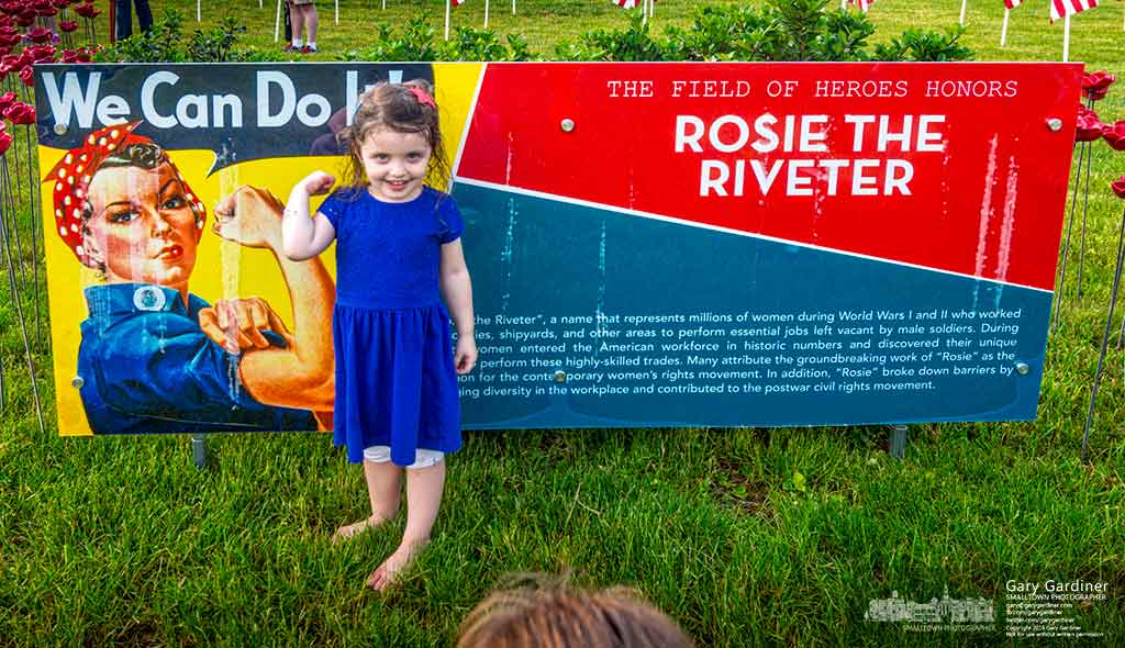 A young girl poses like Rosie the Riveter for her mother who took her photo at the field of Heroes in Westerville. My Final Photo for May 28, 2016.
