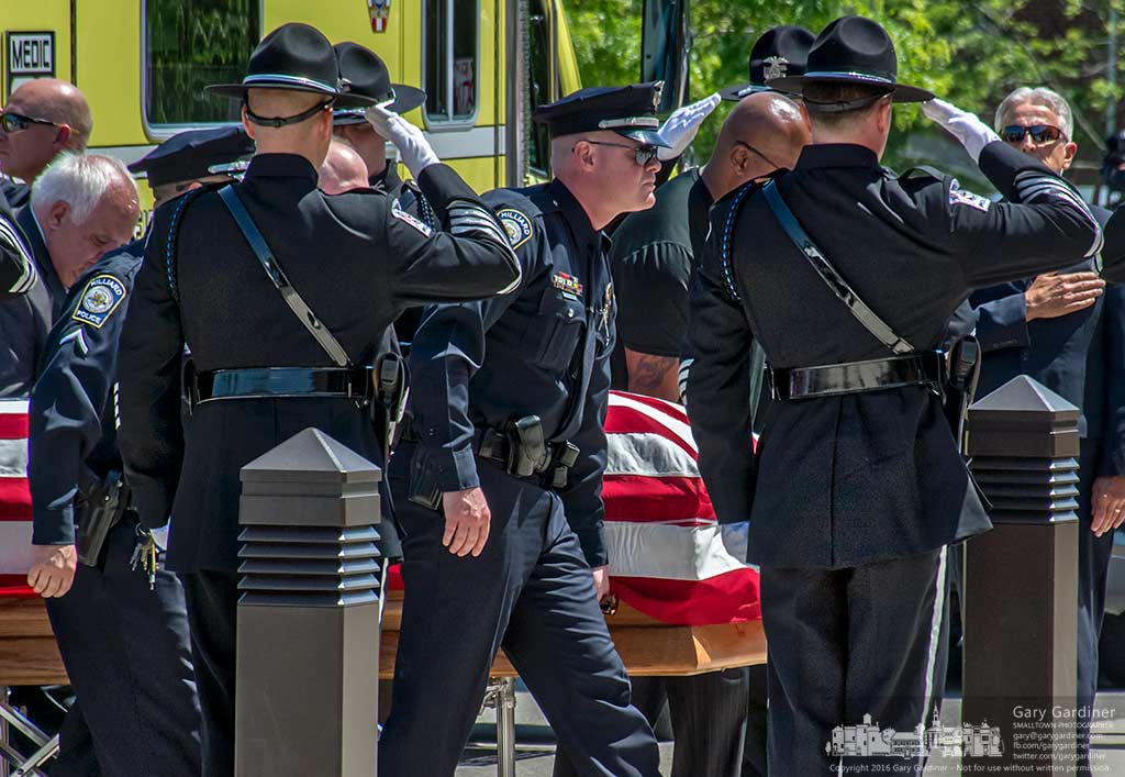 The Hilliard Police Department Honor Guard salutes as pallbearers carry the casket of Officer Sean Johnson into St. Paul Catholic Church in Westerville for his funeral Wednesday. My Final Photo for May 24, 2016.