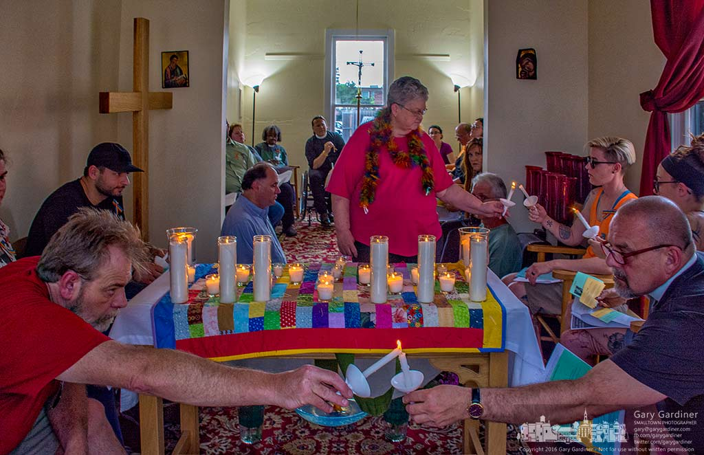 "Members and friends of St. Matthew's Episcopal Church light candles during a Wednesday night service  prayer service dedicated as ""A Time of Prayer and Remembrance for Orlando."" My Final Photo for June 15, 2016."