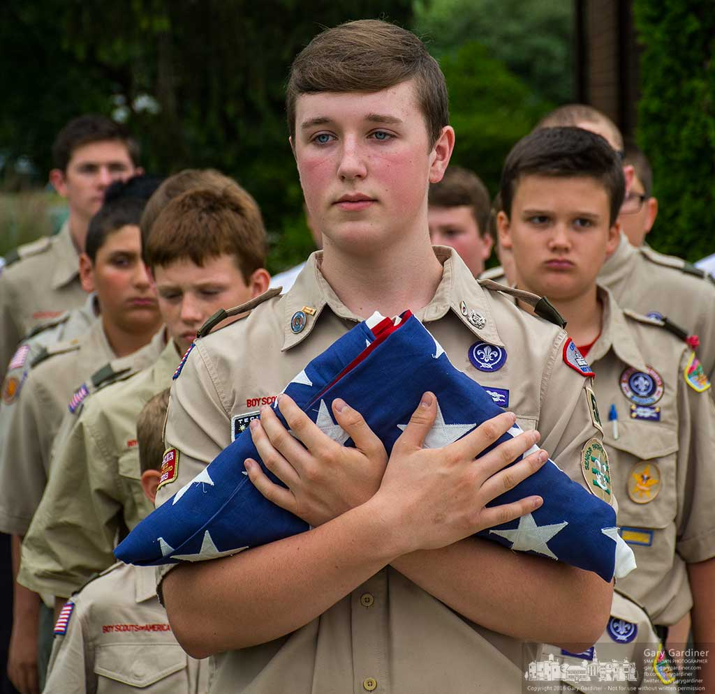 A Life Scout holds the first flag set for retirement during ceremonies on Flag Day at First Responders Park in Westerville, Ohio. My Final Photo for June 14, 2016.