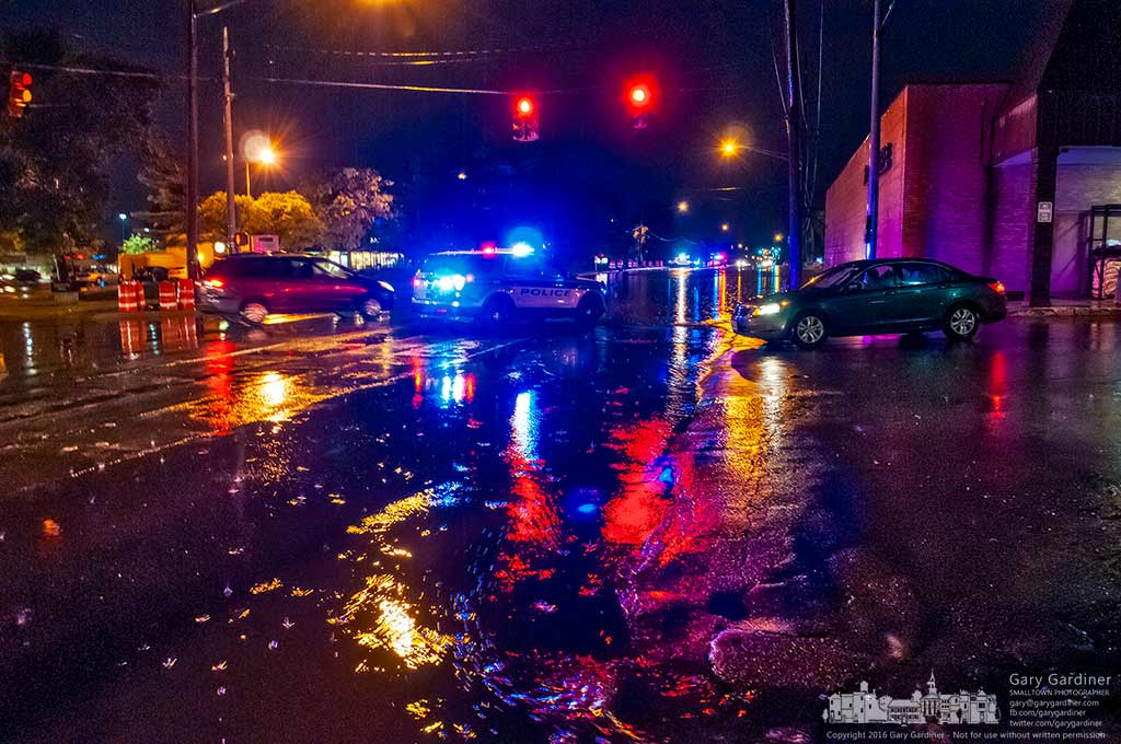 Westerville police block Schrock Road net to Roush Hardware after it flooded during a heavy thunderstorm Sunday night. My Final Photo for June 26, 2016.
