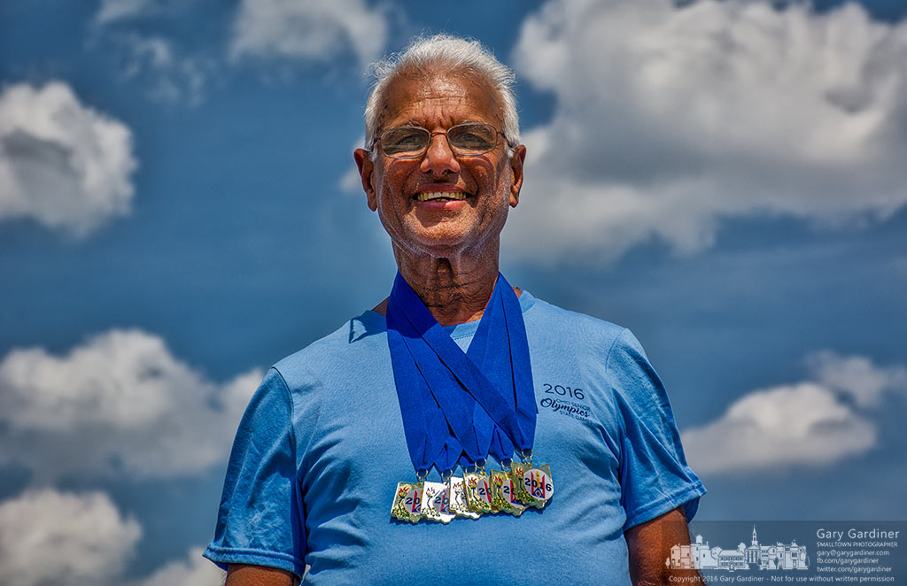 Eighty-year-old Pothen Varughese stands with the six gold medals he received for winning the javelin throw and the 50, 100, 200, 400, and 800 meter runs in the Senior Olympics at Otterbein University Saturday afternoon in Westerville, Ohio. My Final Photo for June 11, 2016.