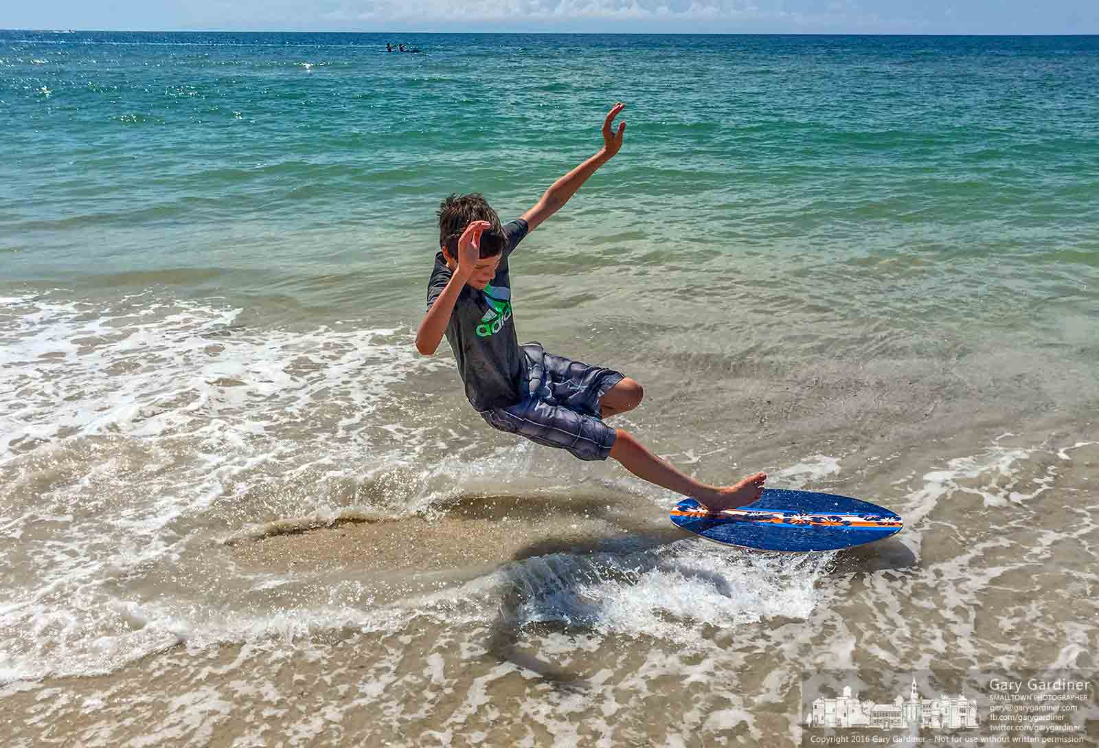 Grandson Ryan discovers it's not as easy as it looks on the YouTube videos as he crashes learning to use his new skimmer in the surf of the Gulf. My Final Photo for July 21, 2016.