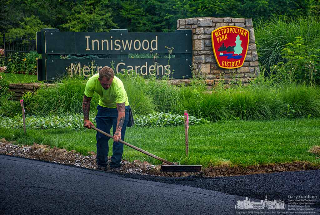 A worker smooths a section of asphalt for the new bike path along Hempstead Road near Inniswood Metro Park. My Final Photo for July 5, 2016.