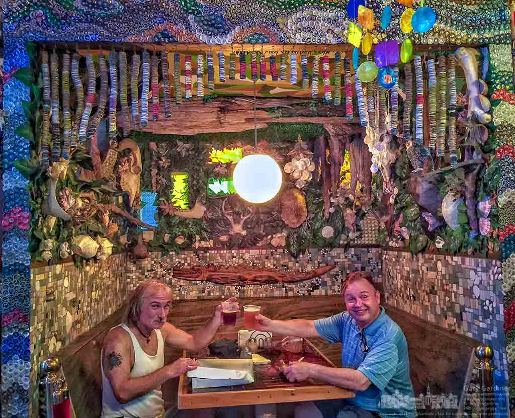 A pair of diners pose with their beers and pizza slices at a booth in the rear section of Satchel's Pizza in Gainesville, Fla. My Final Photo for July 16, 2016.