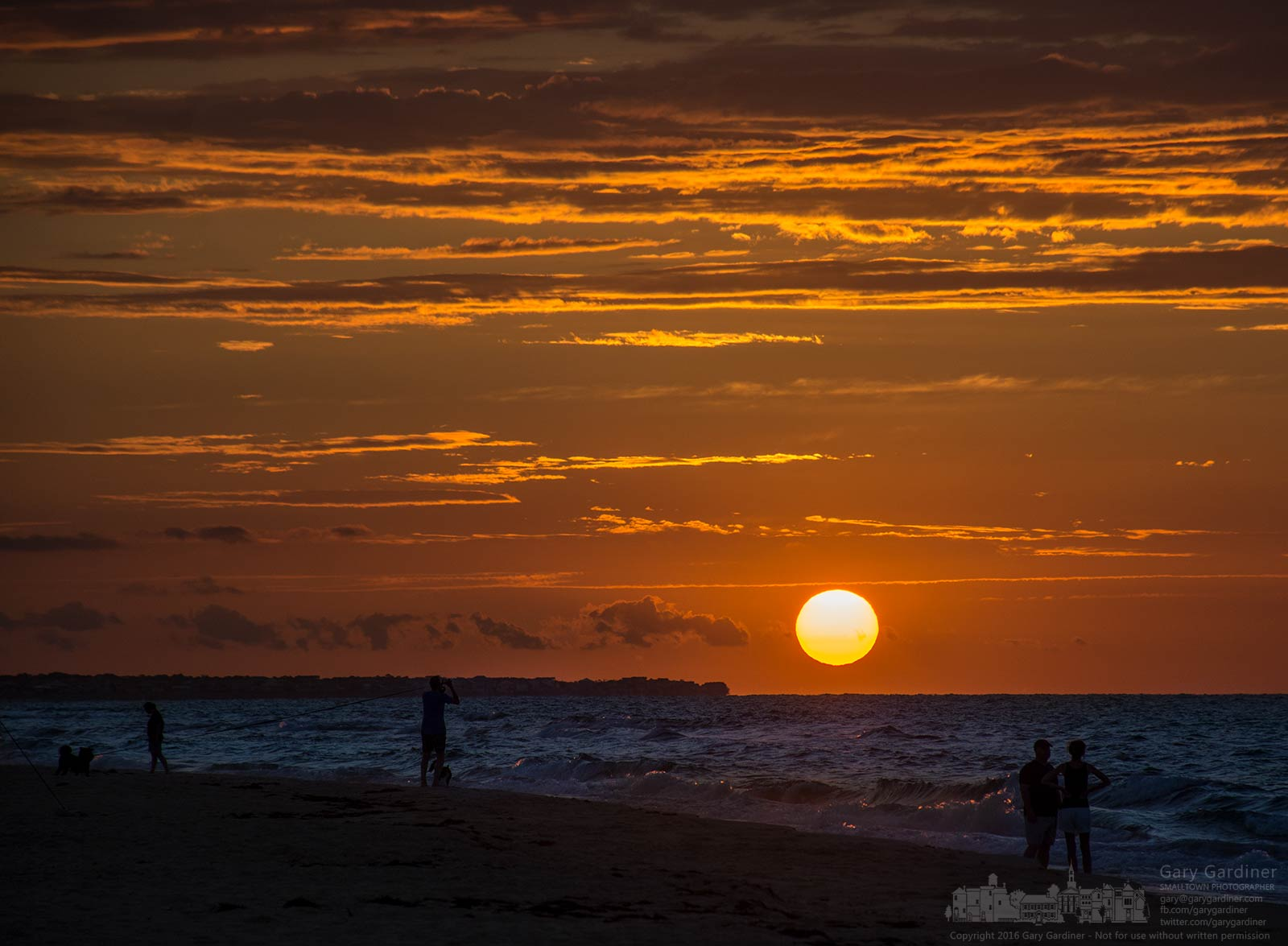 A fisherman, a couple, and a man with his dog watch the sunrise across the point of St. George Island on the Gulf coast of Florida. My Final Photo for July 22, 2016.