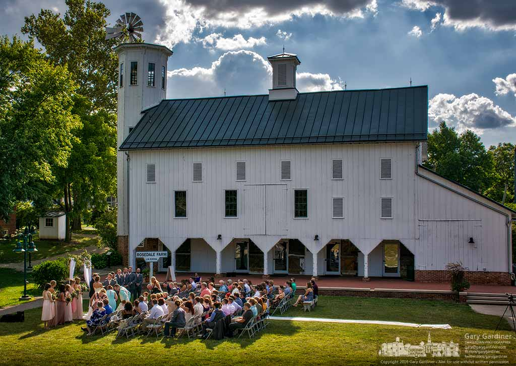 The wedding party settles into their seats as ceremonies began for a late afternoon wedding at the Everal Barn in Heritage Park. My Final Photo for August 7, 2016.