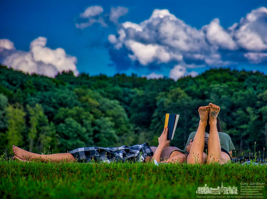 A couple relaxes together on the grassy knoll along the shore of Hoover Reservoir on a cool late summer afternoon. My Final Photo for August 21, 2016.