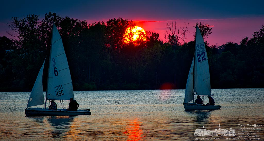 Sailors return to port against the setting sun following an afternoon lesson on Hoover Reservoir in Westerville. My Final Photo for Aug. 4, 2016.