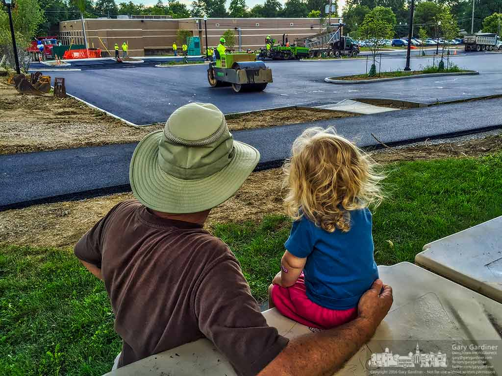 Grandfather and granddaughter share watching as contractors lay asphalt in the parking lot extension for the Westerville Public Library. My Final Photo for August 22, 2016.