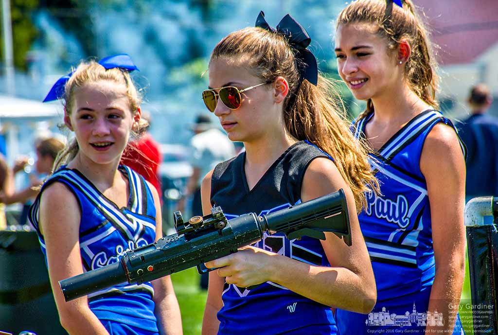A St. Paul cheerleader wields a laser tag gun used to activate other guns during the church's annual picnic Sunday in Westerville, Ohio. My Final Photo for August 28, 2016.