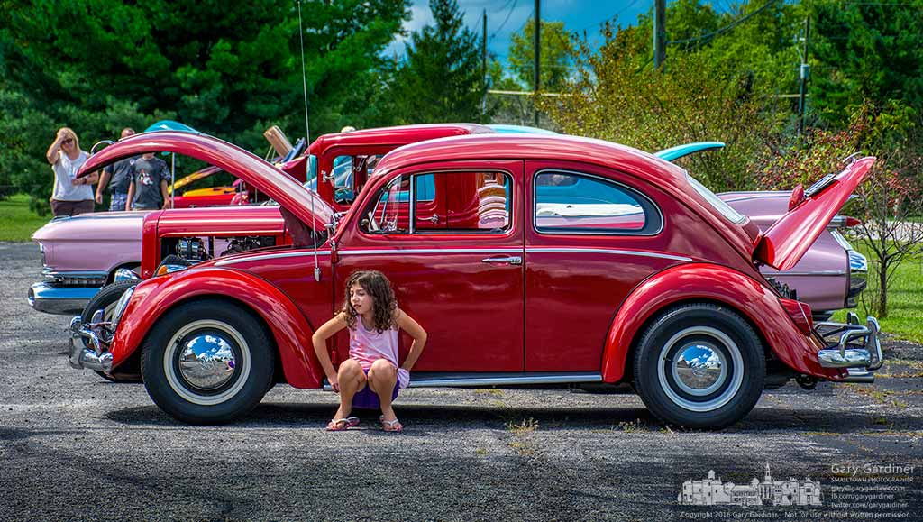 A young girl sits on the running board of her mother's 1963 Volkswagen at a vintage car show at Grace Chapel Community Church. My Final Photo for August 20, 2016.
