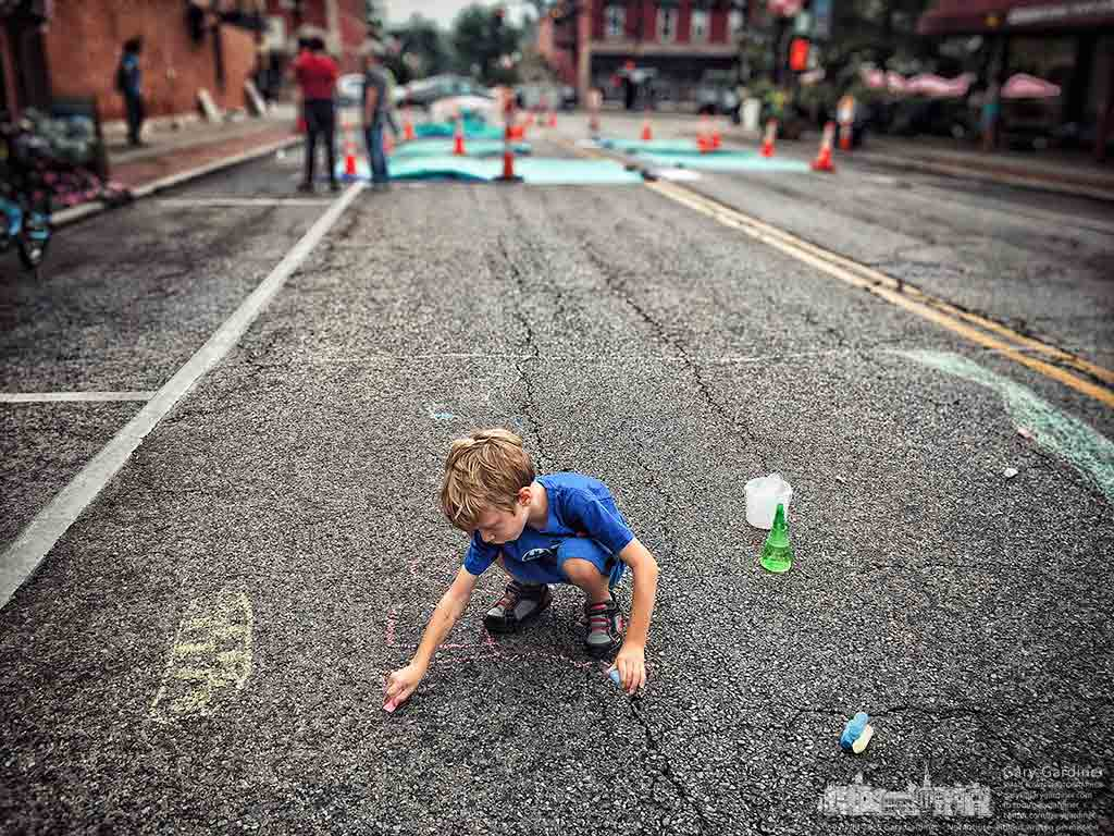 A youngster creates his own chalk drawings along the edge of adult artists making their chalk drawings on West College during the Rock the 'Ville celebration in Uptown Westerville. My Final Photo for Sept. 17, 2016