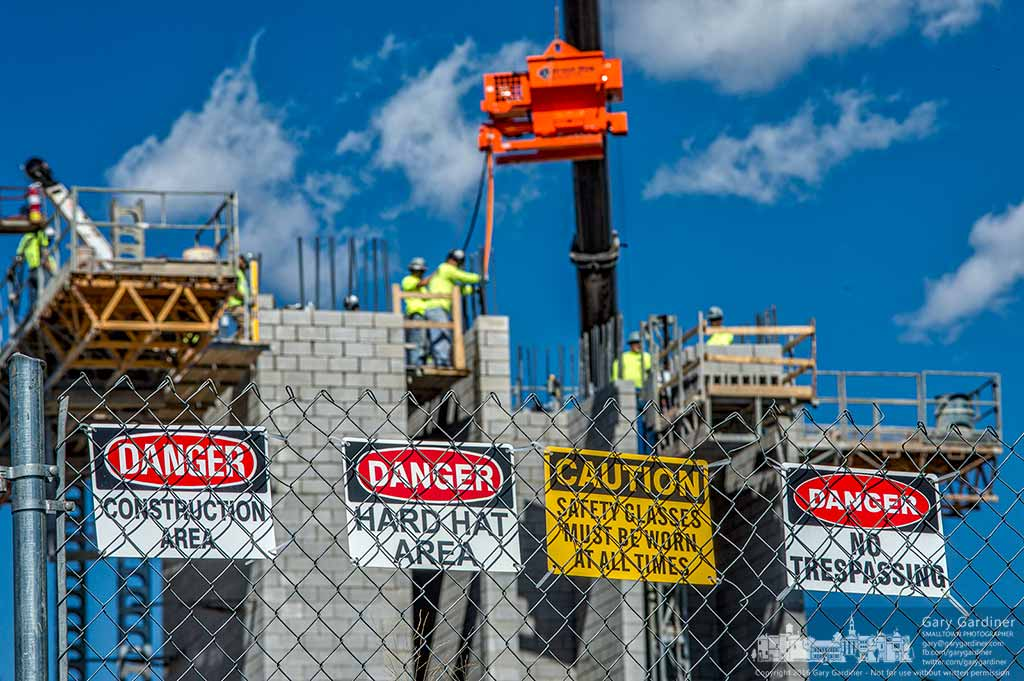 Safety signs mark the perimeter of the Marriott hotel construction site where workers are building three elevator towers. My Final Photo for Sept. 27, 2016.