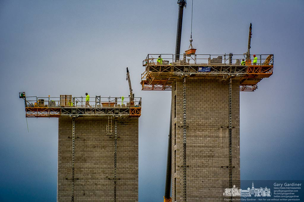Masons work in the early morning laying concrete blocks extending the heighth of three elevator towers for the Marriott Renaissance Hotel being built in Westar near Cleveland and Polaris. My Final Photo for Sept. 26, 2016.