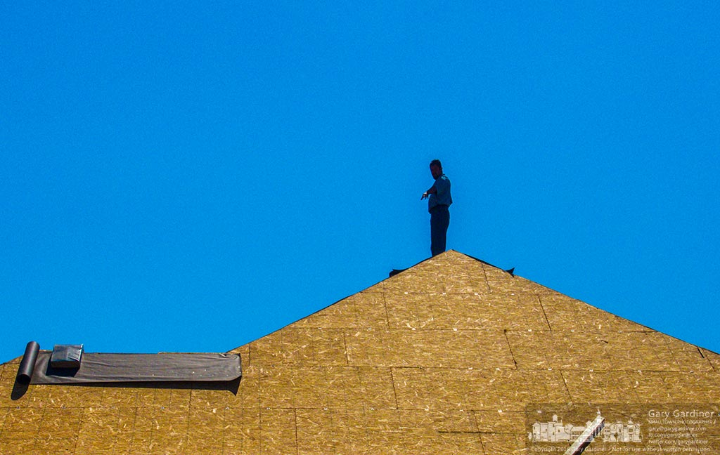 A roofer stands on the peak of a house being built on North State Street. My Final Photo for Sept. 20, 2016.
