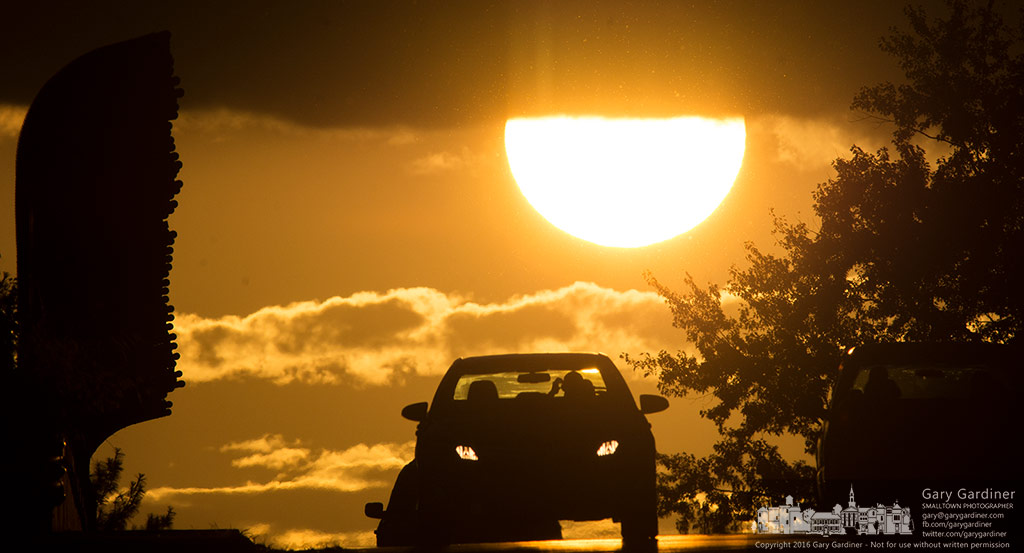 A late afternoon commuter crosses the Dempsey Road bridge as the sun sets in the west. My Final Photo for Sept. 9, 2016.