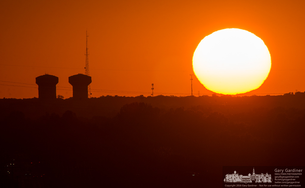 The sun sets over the western edge of Westerville, Ohio, with two of its water towers jutting into the warm sky. My Final Photo for Sept. 12, 2016.