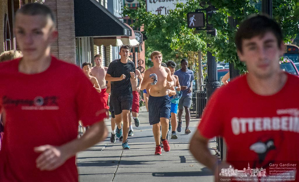Cross country runners navigate through Uptown Westerville on a daily afternoon run. My Final Photo for Oct. 5, 2016.