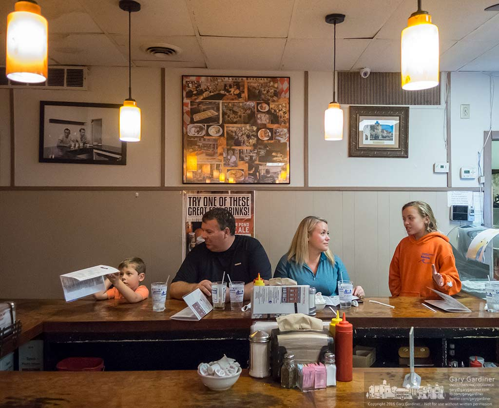 A family settles into their seats ready to place their order at the Hamburger Inn Diner in Delaware, Ohio. My Final Photo for Oct. 20, 2016.