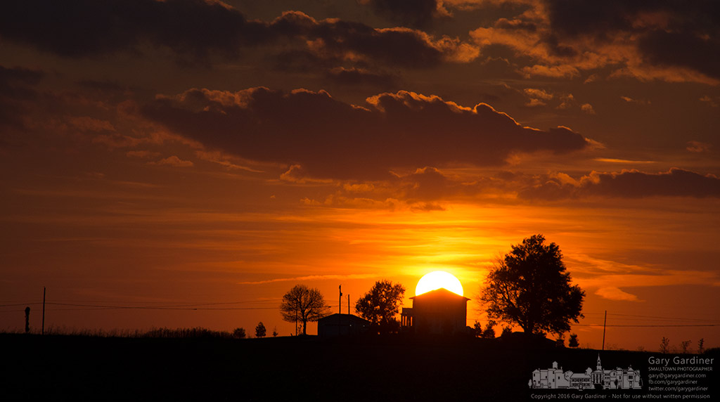 A warm fall sun sets behind a farmhouse on a hill near Croton, Ohio. My Final Photo for Oct. 15, 2016.