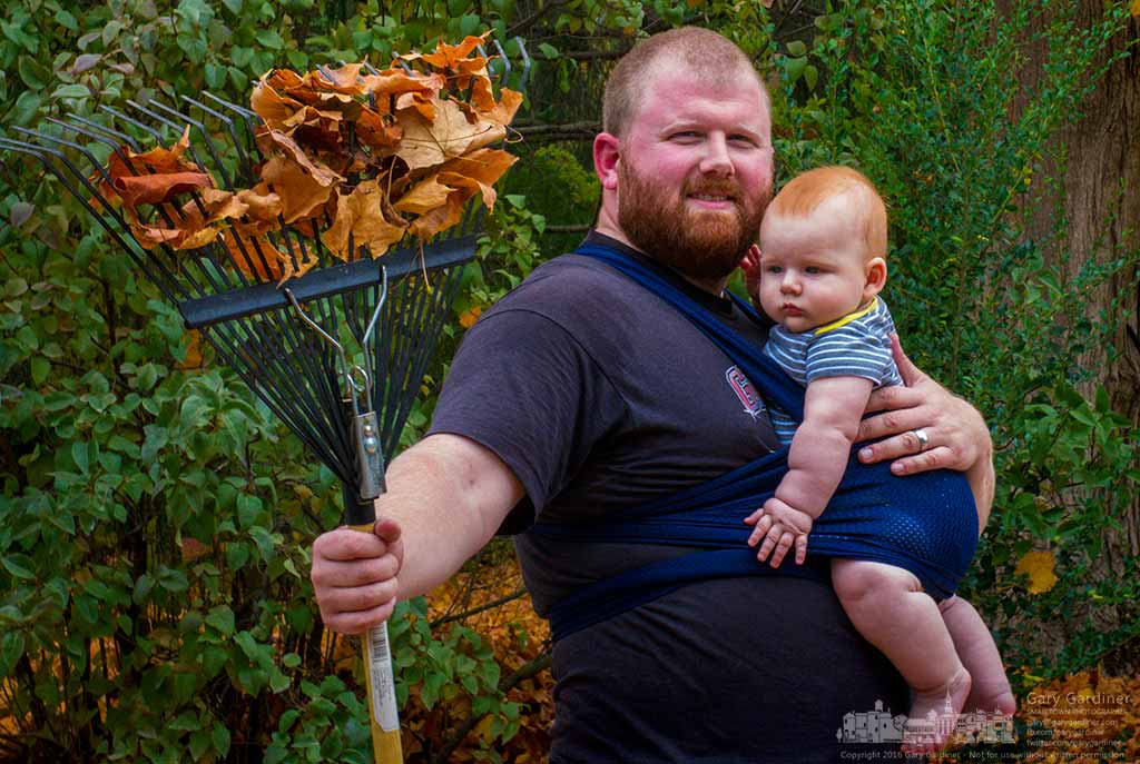 Matthew and Brandon take a break from raking leaves to pose for a photo in the front yard of their Westerville, Ohio, home. My Final Photo for Oct. 18, 2016.
