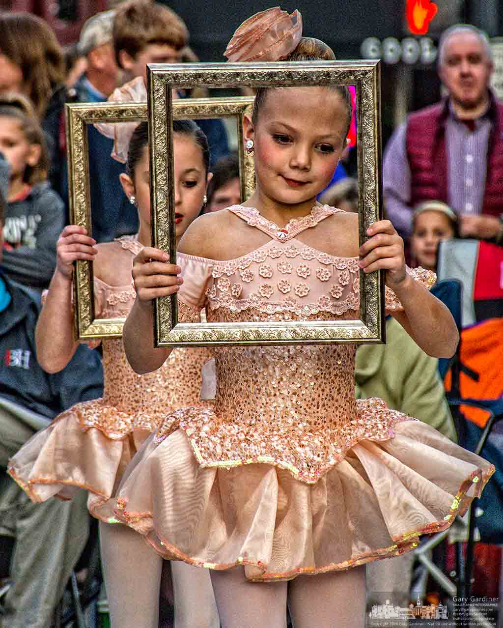 Generations dancers hold frames for props as they step onto the outdoor stage on College Ave. during Midnight Madness in Uptown Westerville. My Final Photo for Oct. 28, 2016.