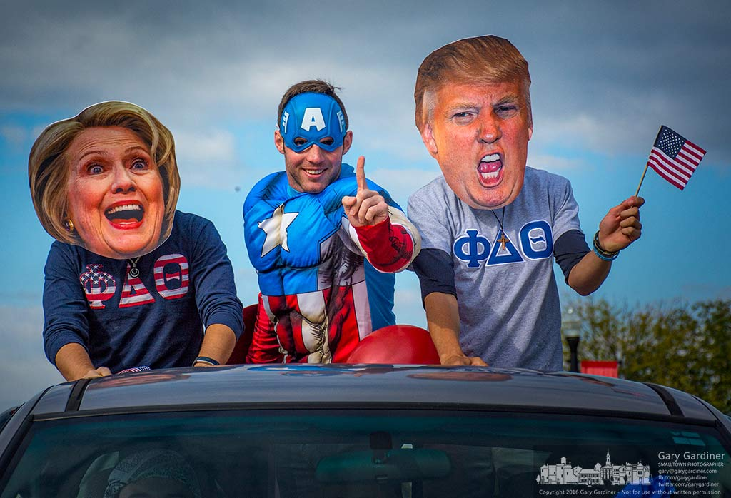 Captain America separates Hillary and Trump masked students on a truck float in the Otterbein University homecoming parade. My Final Photo for Oct. 1, 2016.