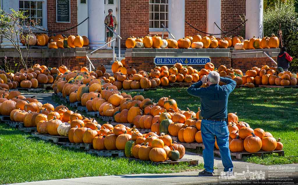 Man pauses to photograph the large collection of pumpkins offered for sale by Boy Scout Troop 560 on the grounds of the Masonic Hall in Uptown Westerville. My Final Photo for Oct. 9, 2016.