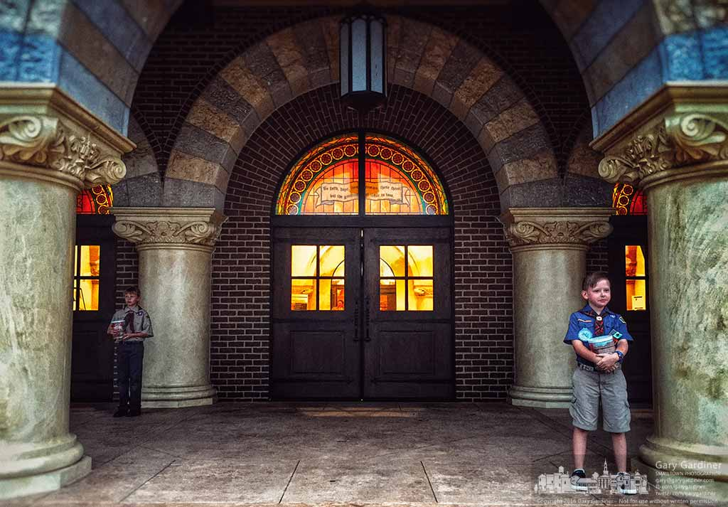 Boy Scouts stand at the main door of St. Paul the Apostles Catholic Church ready to tell people about the popcorn sale the troop's having after masses on Sunday. My Final Photo for Oct. 2, 2016.