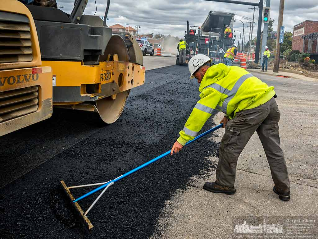 A worker bevels the edges of a fresh layer of asphalt on State Street where it meets Schrock Road. My Final Photo for Oct. 22, 2016.