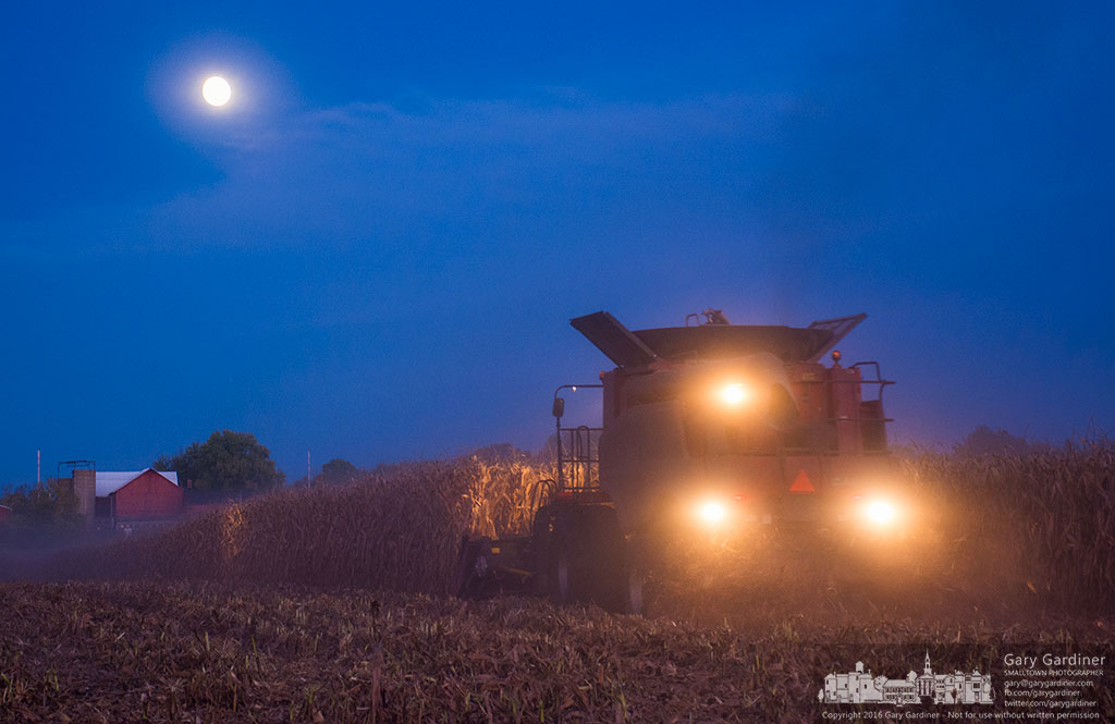 Francis McNamara runs his combine through a field of corn on the Yarnell Farm under the rising moon. My Final Photo for Oct. 14, 2016.