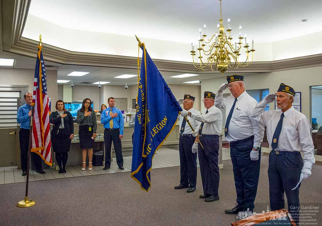 Members of Westerville American Legion Young-Budd Post 271 leads the employees of 5/3 Bank on North State Street in the Pledge of Allegiance after presenting them with a flag honoring the bank's contributions to veterans. My Final Photo for Nov. 8, 2016.