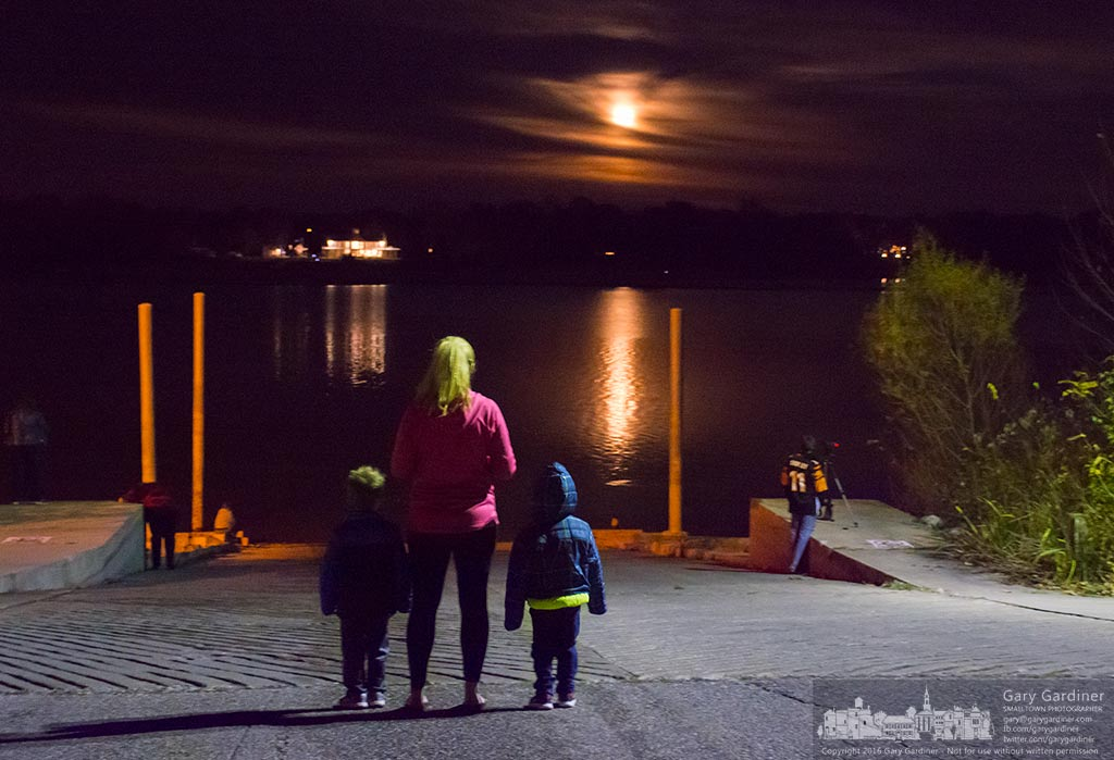 A mother and her children stand on the boat ramp at Red Bank at Hoover Reservoir watching as the Super Moon rises of the lake. My Final Photo for Nov. 14, 2016.
