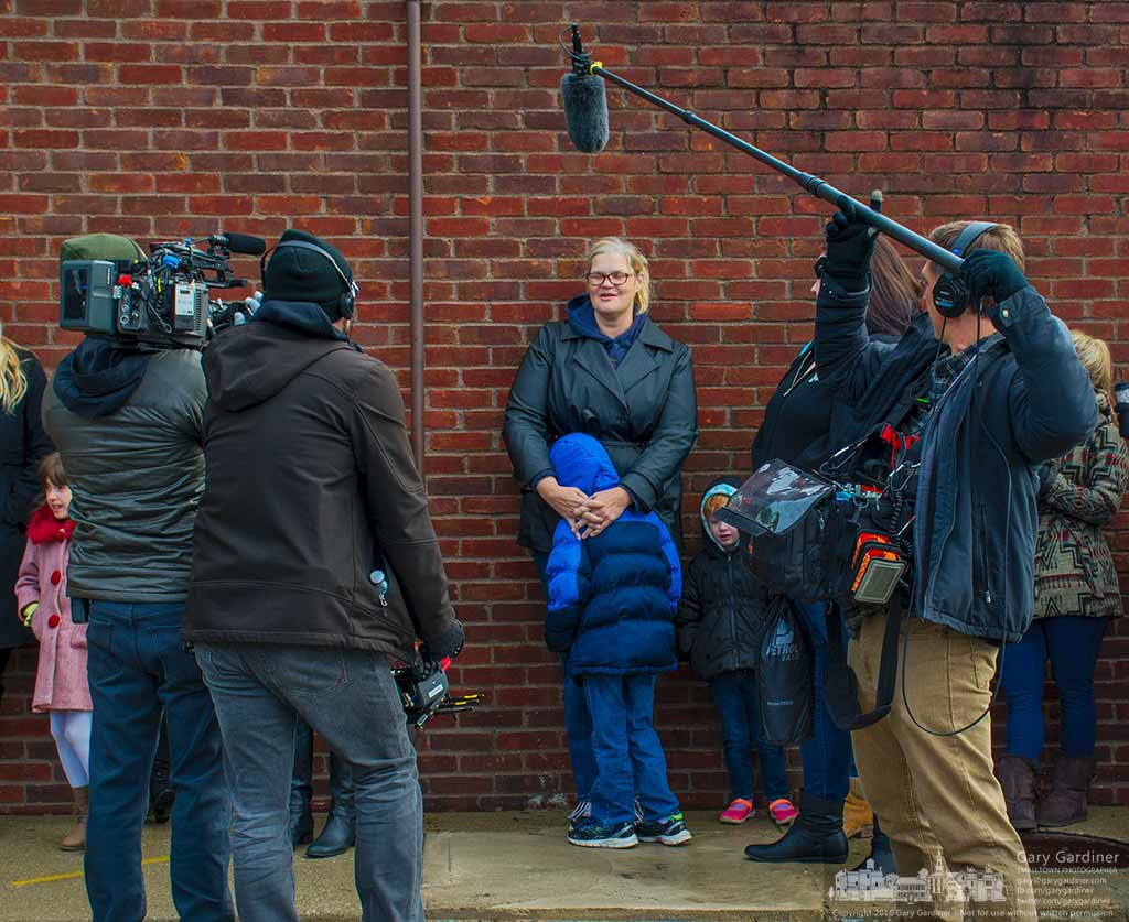 The Morgan Spurlock documentary crew interviews a woman with her child as they wait in line for the grand opening of Holy Chicken!, Spurlock's popup restaurant in Columbus. My Final Photo for Nov. 19, 2016.