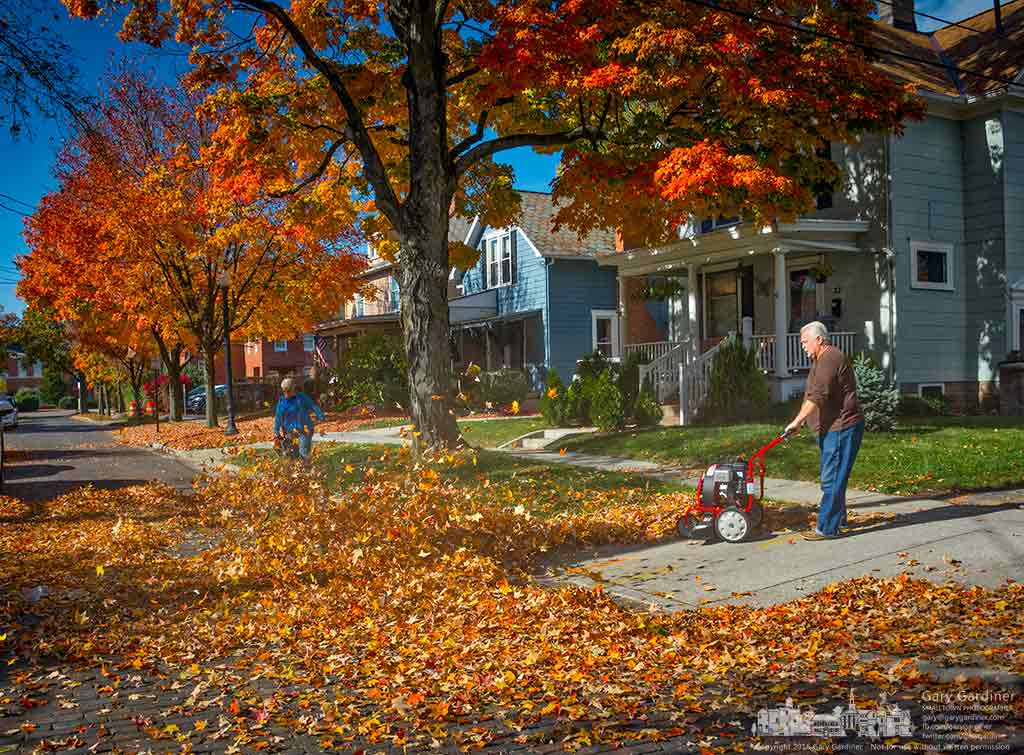 Albert and Victoria blow leaves from their yard on Winter Street into a large pile across the street for collection by the city. My Final Photo for Nov. 5, 2016.