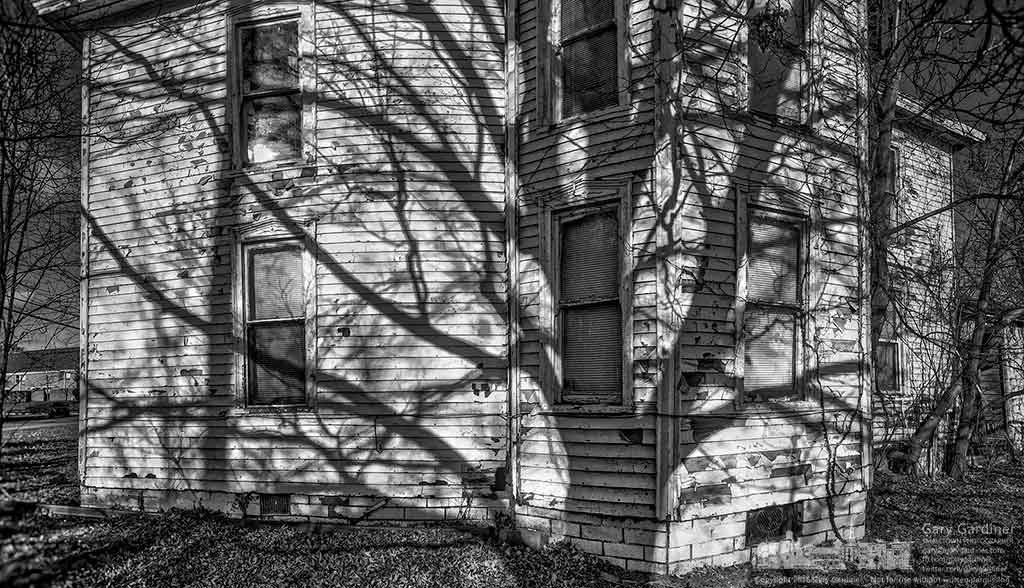 Shadows from trees along the edge of a hay field fall on the old farm house at the Braun Farm property on Cleveland Ave. My Final Photo for Dec. 27, 2016.