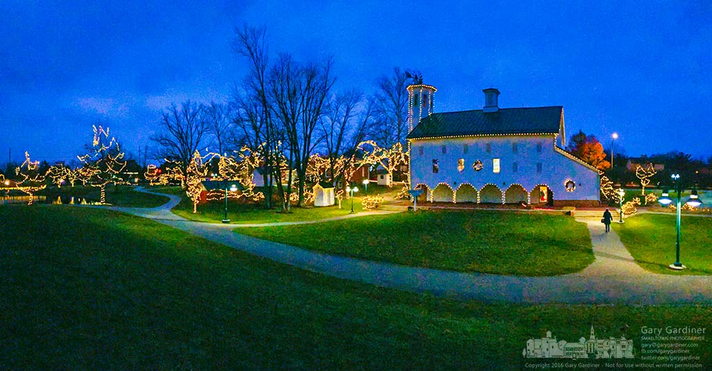 A woman walks towards the Everal Barn at Heritage Park during Snowflake Castle when the city park is brightly lit by Christmas lights for the holidays. My Final Photo for Dec. 8, 2016.