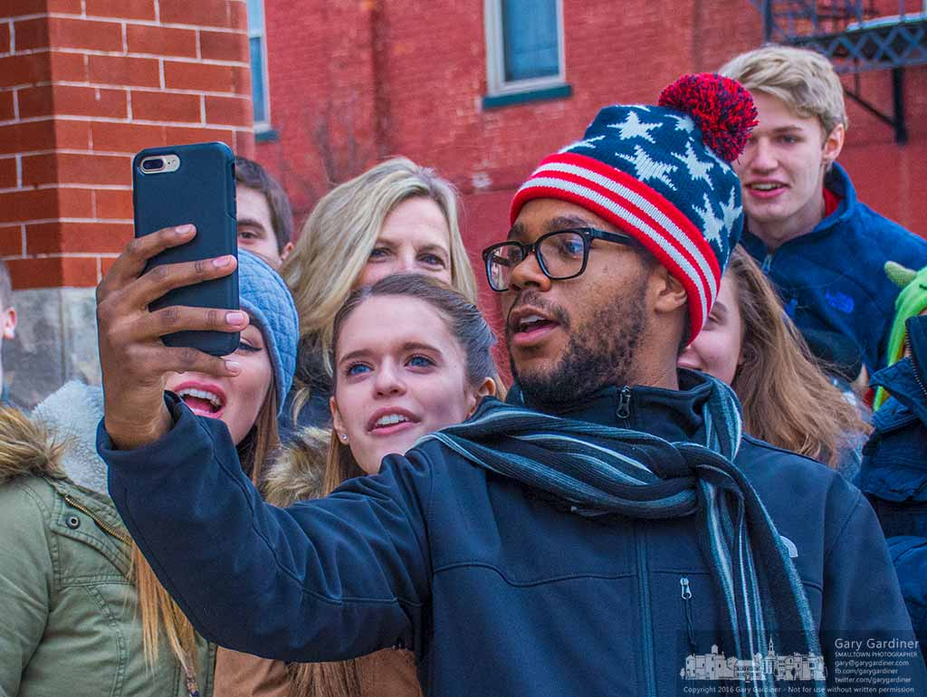 Soundsation, the choral performing arts group from Westerville South broadcasts an impromptu Facebook Live feed between performances of Christmas music in businesses in Uptown Westerville. My Final Photo for Dec. 16, 2016.