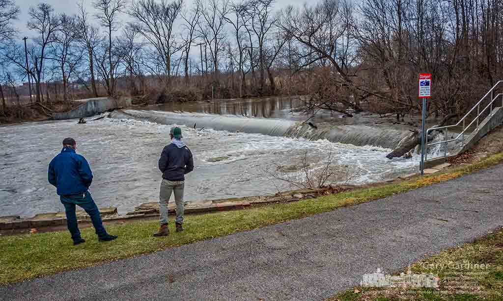 A pair of anglers watch the waters of Alum Creek rushing over the low-head dam as they try to decide where to fish Friday afternoon. My Final Photo for Jan. 13, 2017.