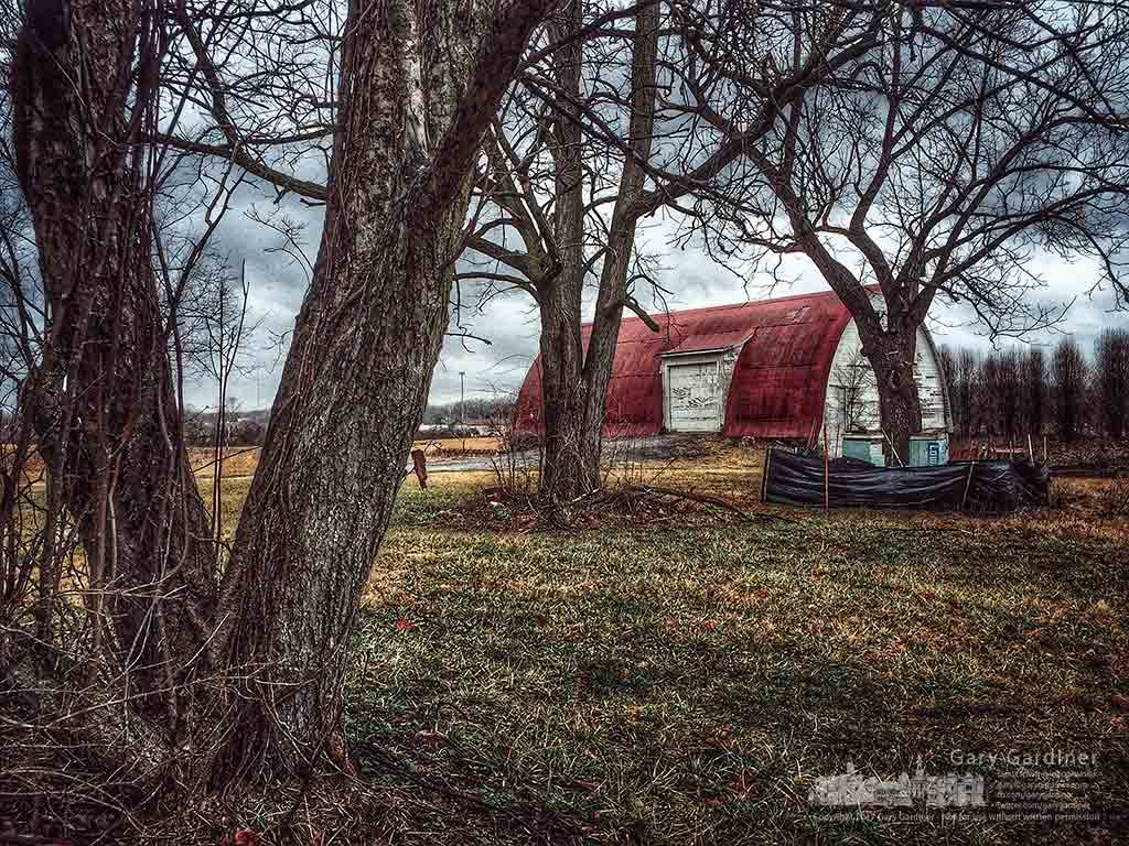 Even on a warm winter day the dreary colors of the season show how the farm lies fallow until the first warm days of spring. My Final Photo for Jan. 23, 2017.