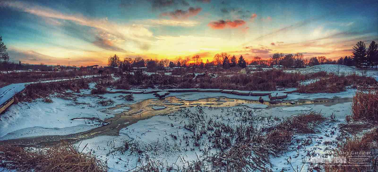 Temperatures in the low teens freezes the slow-moving waters at the Highlands Park wetlands as the sun sets bringing colder overnight temperatures. My Final Photo for Jan. 6, 2016.