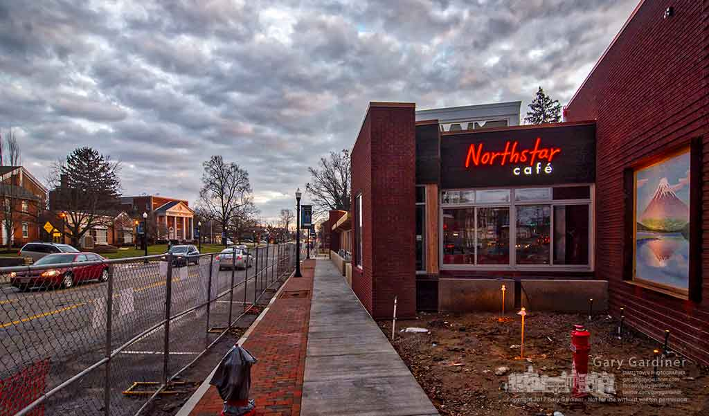 One of the signs on the news Northstar Cafe in Uptown Westerville is lit after electricians installed the neon tubes in the shadow box letters of the sign. My Final Photo for Jan. 20, 2017.