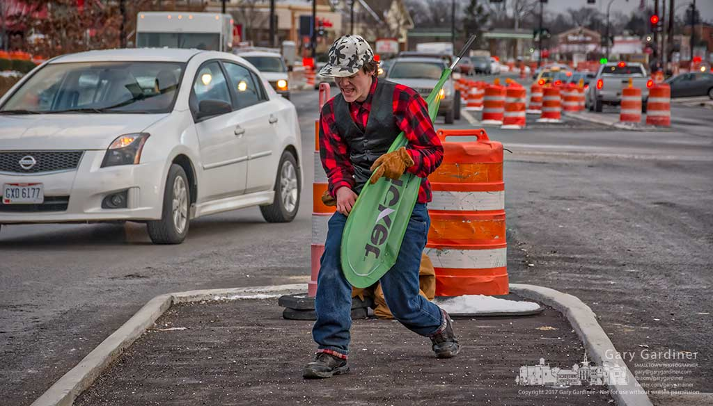 With Michael Jackson as his musical accompaniment a Cricket Wireless sales rep dances in the median at State and Schrock to draw customers to the business in Westerville Square Shopping Center. My Final Photo for Feb. 9, 2017.