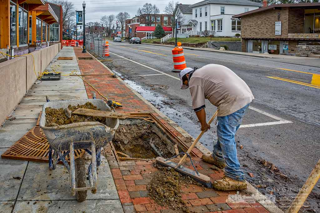 A landscaper cleans up around a hole dug for one of the trees that will line the sidewalk outside the Northstar Cafe in Uptown Westerville when it opens next month. My Final Photo for Feb. 22, 2017.