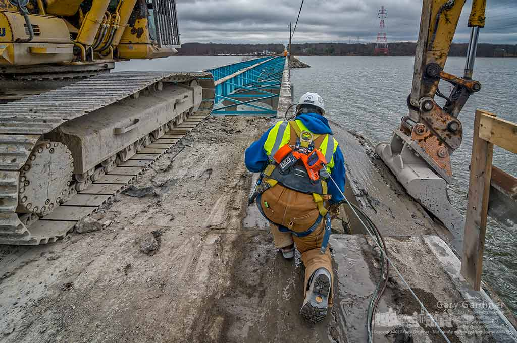 A welder cuts away a reinforcing rod that kept the work crew from removing a section of the concrete deck of the Smothers Road bridge over Hoover Reservoir. My Final Photo for Feb. 27, 2017.