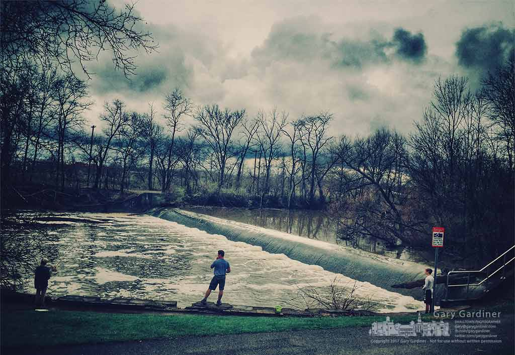 A father and sons fish below the rushing waters at the lowhead dam at Alum Creek Park North. My Final Photo for March 31, 2017.
